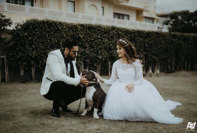 indian bride and groom with the pet dog