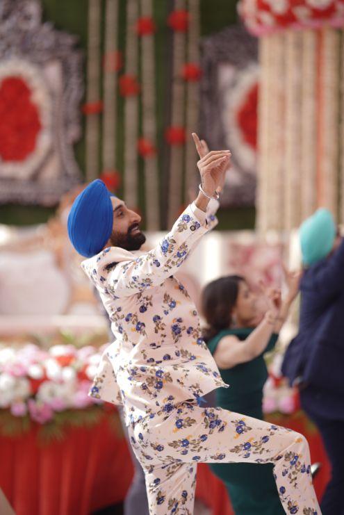 dancing indian groom