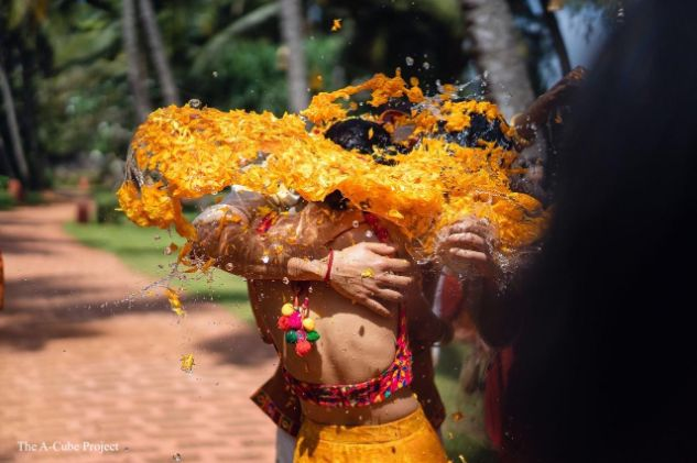 drenched in floral holi colors  wedding in Kerala