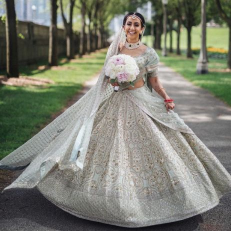 Ivory lehenga for this beautiful Indian Bride