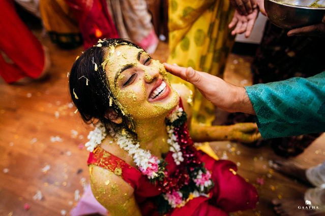 candid pictures from haldi ceremony | indian bride in floral jewellery for haldi