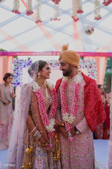 stunning varmala for the couple in pink | Jaipur Wedding