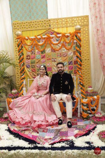 couple photo shoot at mehendi   Modern Customised Lehenga Embroidery