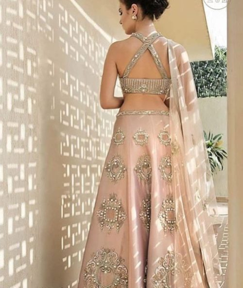 criss cross back blouse design for indian brides | indian bridal lehenga back blouse designs 2020 peach bridal lehenga | | peach bridal lehenga south indian style blouse designs for 2020 indian brides | indian style back blouse designs | #weddings #wittyvows #lehenga