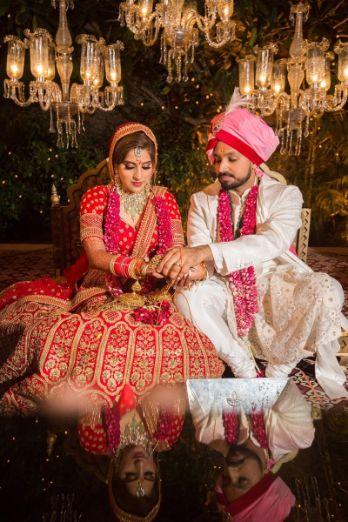indian wedding rituals | Sabyasachi Bride in red lehenga