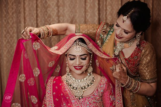 mother daughter photography | Gorgeous Sabyasachi Lehenga in Pink - Delhi Wedding