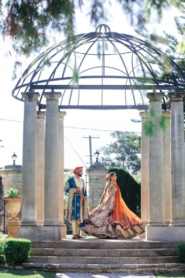 bride twirling for pohotoshoot   indian wedding photos   Cutest Surprise Proposal Ideas