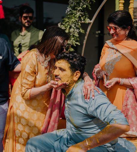 groom submerged in haldi | indian wedding rituals