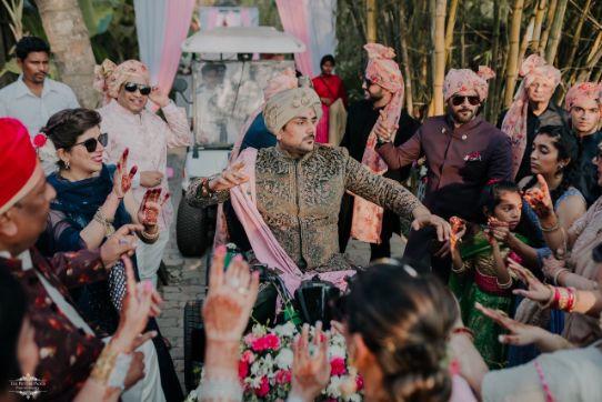 dancing groom | Stunning Colourful Wedding Lehenga