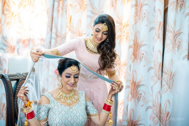 indian bride getting ready photos | Pastel Wedding with a Stunning Reception Look