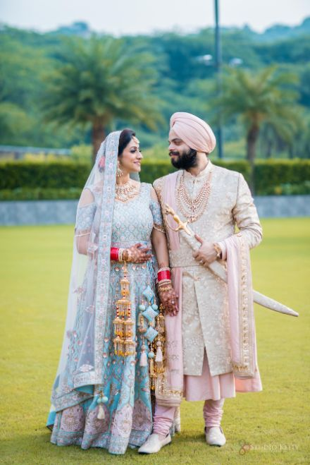 pastel blue outfit | pastel pink sherwani for the bride | Pastel Wedding with a Stunning Reception Look
