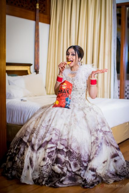 indian bride eating chips | Stunning Reception Look