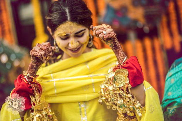 indian bride immersed in haldi   Mirror Work Lehenga for Mehendi