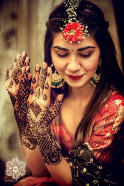 indian bride at her mehendi ceremomy   Mirror Work Lehenga for Mehendi