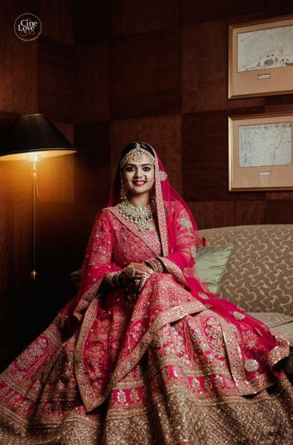 beautiful indian bride in red lehenga | Gorgeous Sabyasachi Lehenga in Pink - Delhi Wedding