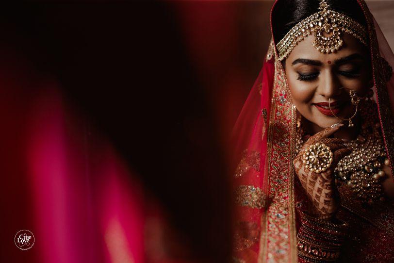 bridal poses | Gorgeous Sabyasachi Lehenga in Pink - Delhi Wedding