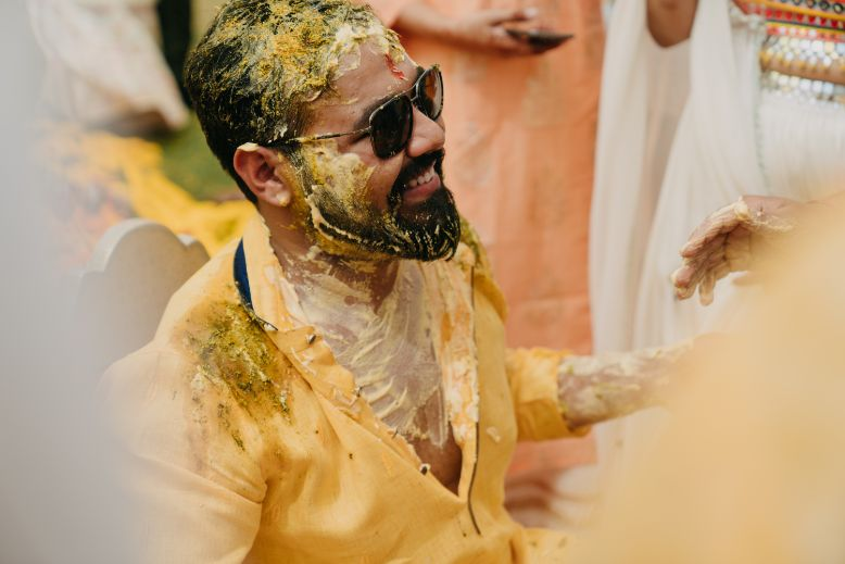 candid grooms photo on haldi day