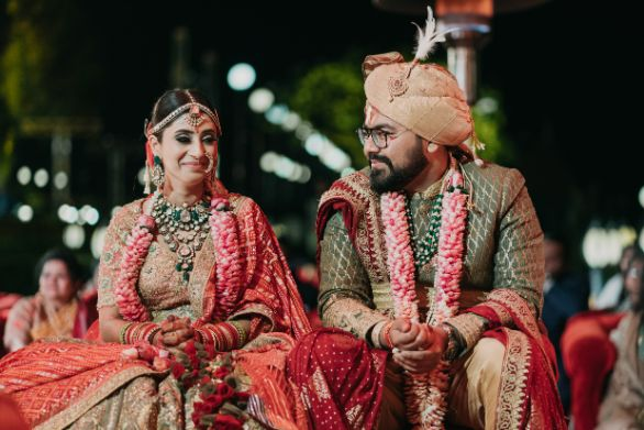 candid groom and bride captured at wedding ceremony | Destination Wedding in Udaipur