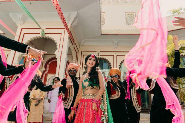 bride in pretty pink lehenga for her mehendi day