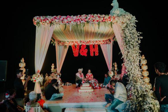 stunning mandap decor | with couple initials | Stunning Colourful Wedding Lehenga - Beautiful Goa Wedding