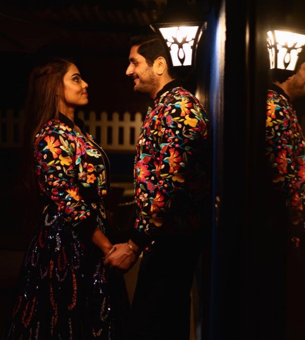 couple in matching bomber jackets for cocktail ceremony