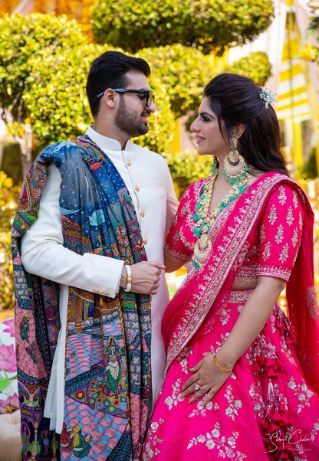 bride and groom candid photo | pink lehenga for the bride