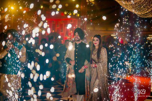 indian couple reception entry ideas | Sabyasachi Saree in Gold Sequins