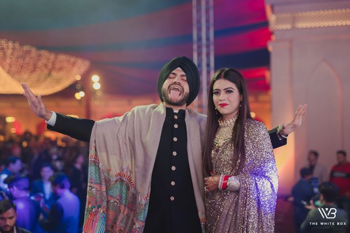 sikh bride and groom on reception day | Sabyasachi Saree in Gold Sequins