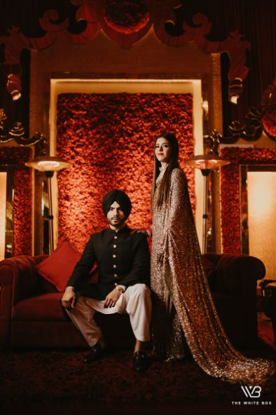 indian couple post wedding photography poses | Sabyasachi Saree in Gold Sequins