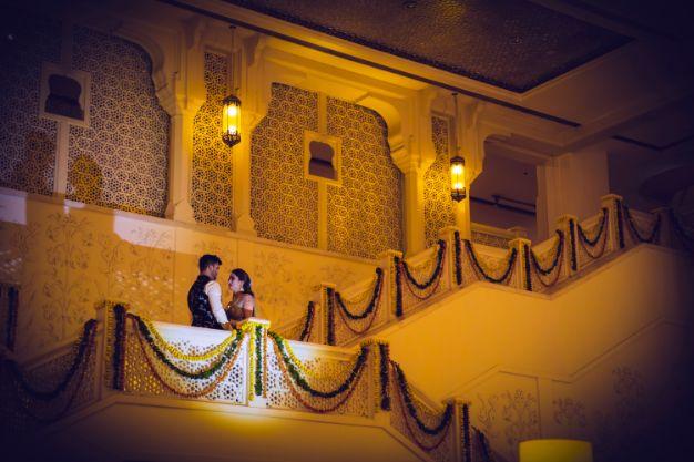 bride and groom photo shoot on sangeet day | Printed Lehenga  & a Gorgeous Off Shoulder Blouse - Megnha & Devansh