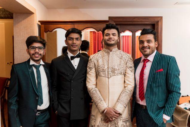 indian groom posing with grooms men