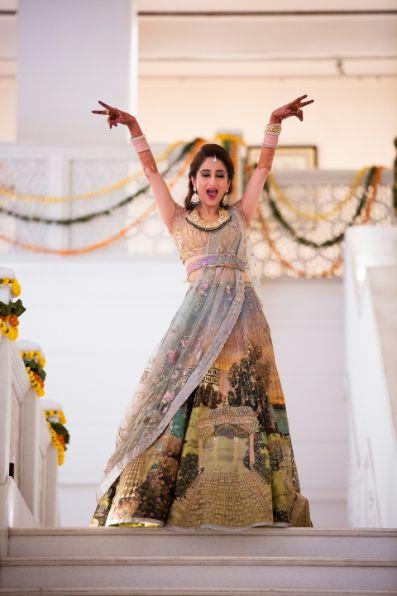 indian bride dancing on sangeet night   Printed Lehenga  & a Gorgeous Off Shoulder Blouse - Megnha & Devansh
