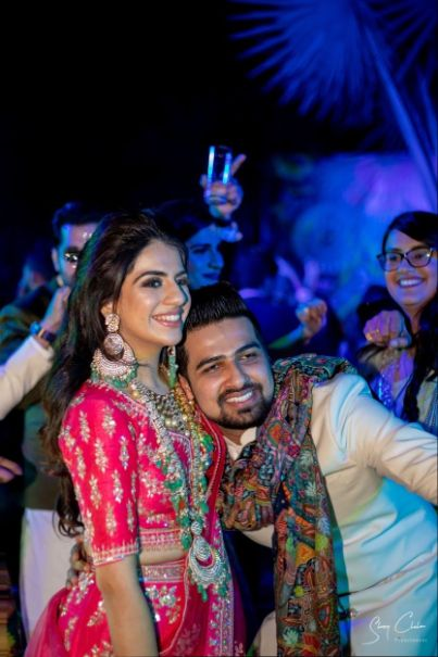 bride and groom at their sangeet ceremony