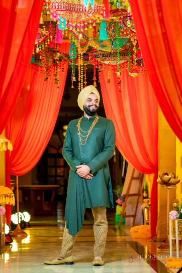 green outfit for the groom | indian groom