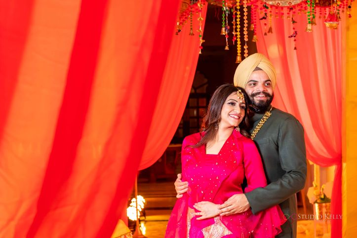 couple shoot poses for sangeet night