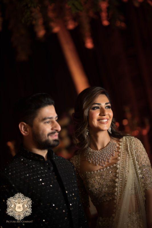 indian couple candid engagement capture   Mirror Work Lehenga for Mehendi