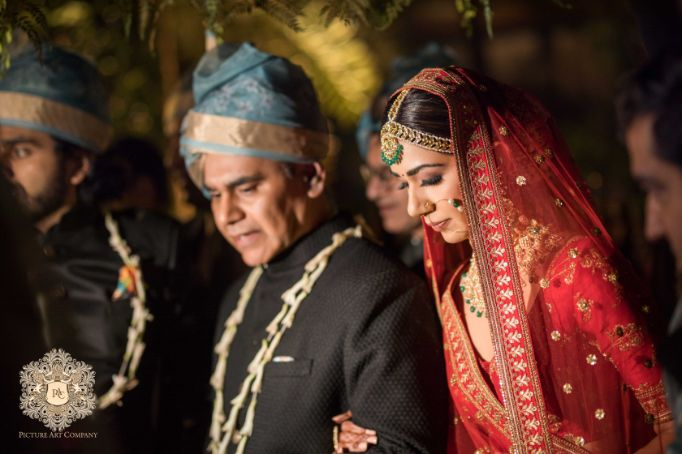 bride entering with her father on wedding day