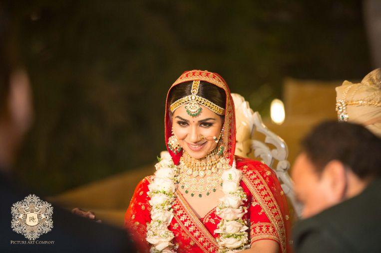 stunning bride in red lehenga
