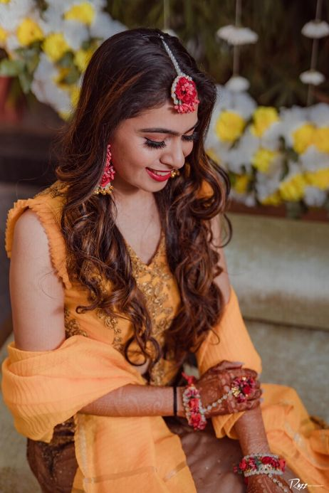 candid haldi capture   indian wedding   bridal makeup   bridal hair