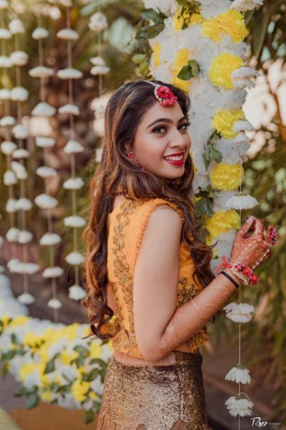 indian haldi hairstyle | floral jewellery for the bride