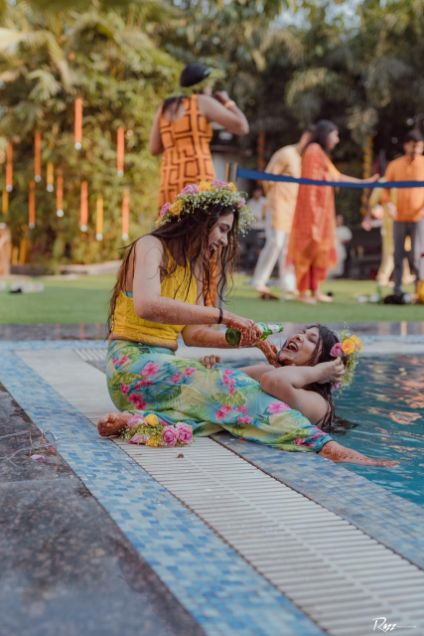 bride having fun with friends | haldi ceremony | Haldi Ceremony with A Pool Party Theme