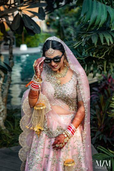 bride in stunning pastel pink lehenga | Beach Wedding in Sri Lanka