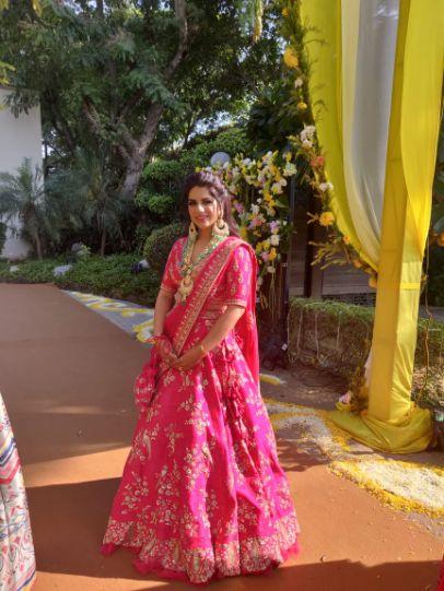 bride in beautiful pink lehenga