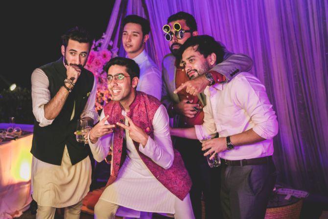 family having fun photography at an indian wedding