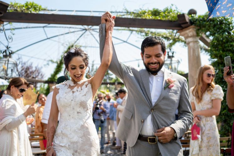 forma; bridal gown at nri indina wedding | white bridal gown | tuscany wedding indian couple dancing