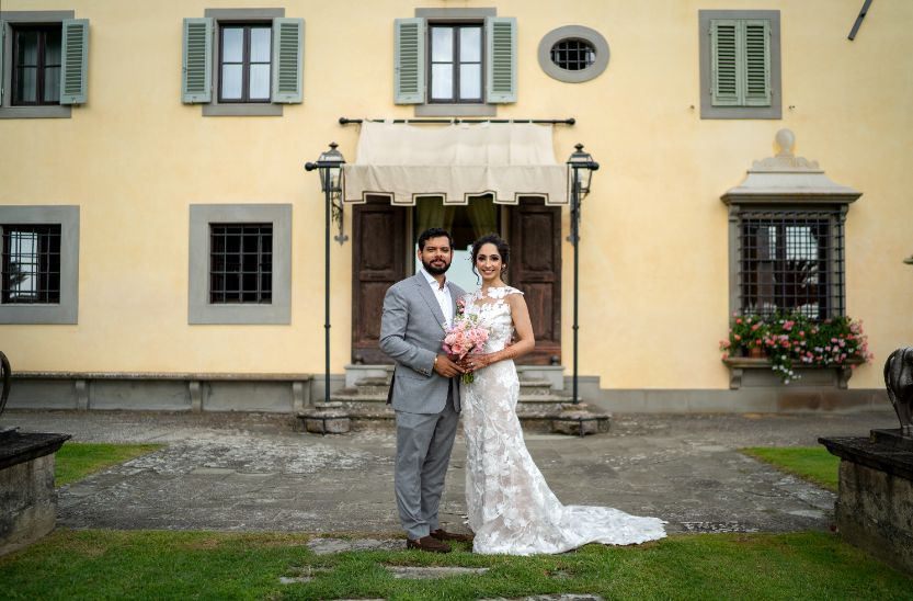 christain couple wedding portrait | inain couple photosoot | forma; bridal gown at nri indina wedding | white bridal gown | tuscany wedding indian couple dancing