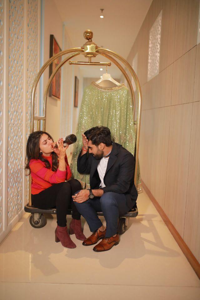 funny couple moments green sabyasachi lehenga | indian bride groom | wittyvows | bridal lehenga | floral wedding | chomu palace