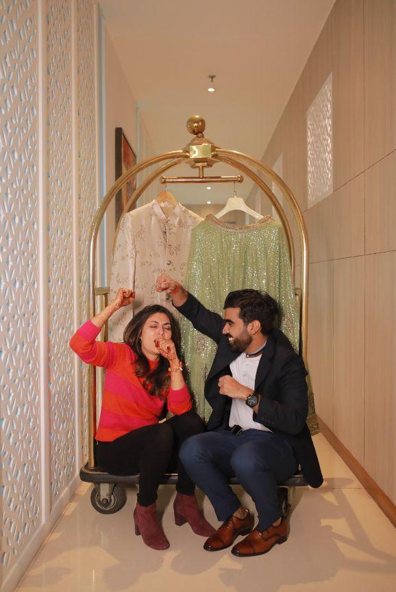 funny couple moments green sabyasachi lehenga   indian bride groom   wittyvows   bridal lehenga   floral wedding   chomu palace