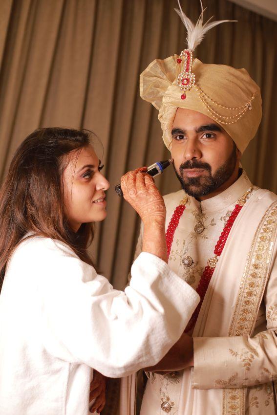 couple doing makeup funny couple moments green sabyasachi lehenga   indian bride groom   wittyvows   bridal lehenga   floral wedding   chomu palace