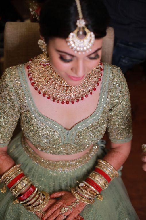 close of indian bride   indian bridal jewllerey   wittyvows   chooda designs   nude makeup look destination wedding